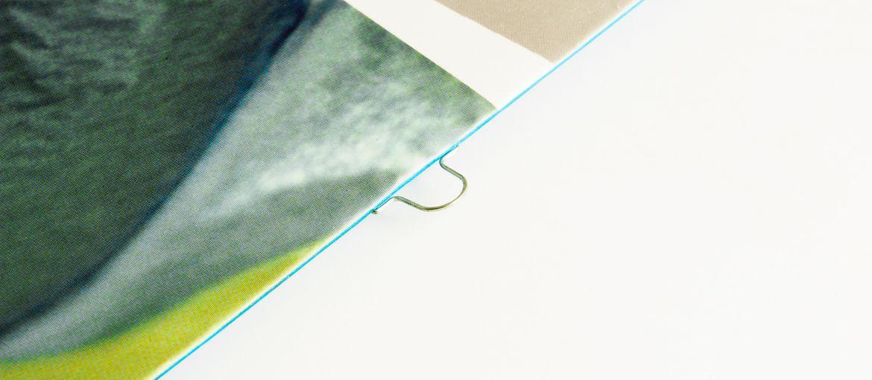 Online printing Optikon Brochure: Print: 4 colours Paper: matt coated 300 gsm Processes: double omega stapled (omega staple detail)