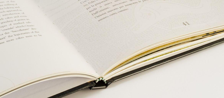 Reliure en couverture cartonnée: Reliure en couverture cartonnée : voici comment imprimer un livre en couverture cartonné. Apprenez tout sur l'impression numérique avec Sprint24.
